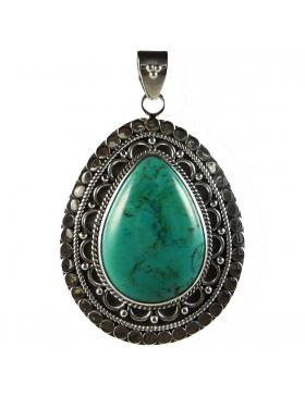 Gros pendentif oriental en turquoise bleue